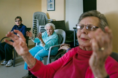 Elderly Women Raising Their Hands
