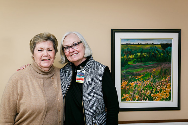 Elderly Women in Front of a Painting