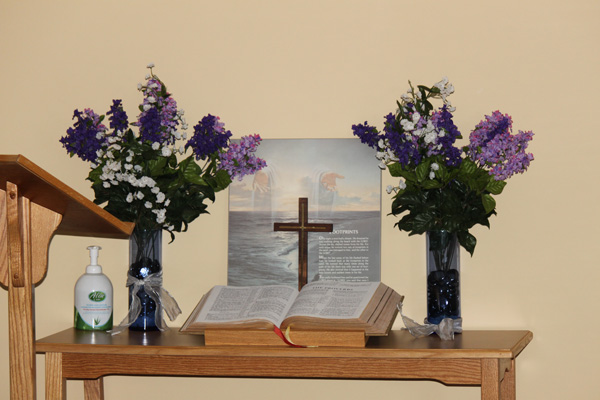 bible and cross on a table